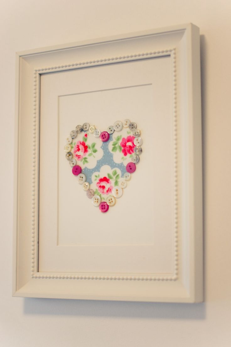 card with cut out heart pasted onto fabric - could use thick cardboard and paper-mache then paint?
