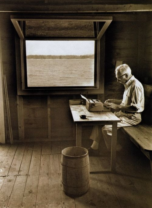 E.B. White writing in his boat shed overlooking Allen Cove, 1976.