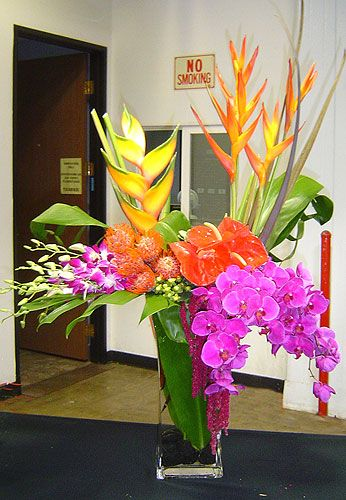 Contemporary Tropical Vase arrangement by Marisa Perring, AIFD