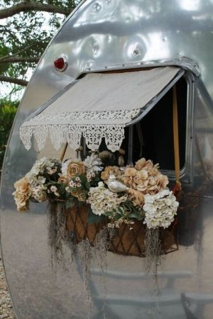 glamour camping * thinking of dressing up something like this for the cat window cage.   Any thoughts?