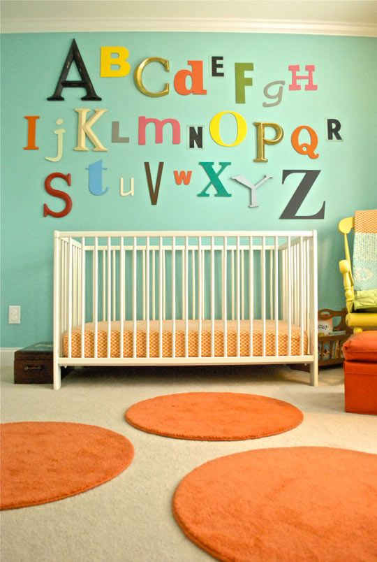 nursery with wall alphabet and small rugs. http://www.apartmenttherapy.com/ross-very-vintage-modern-marve-153648