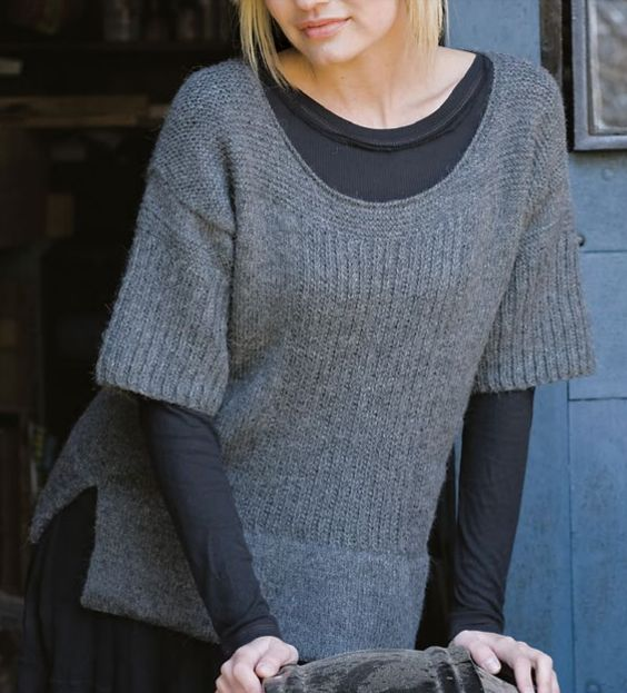 Free Knitting Pattern for Umiah Short Sleeved Pullover Sweater - This pullover features a deep u-neck, ridged bodice, short drop-shoulder sleeves, and side seam slits..Great for layering! Designed by Berroco who rated it easy. X-Small, Small, Medium, Large, 1X, 2X