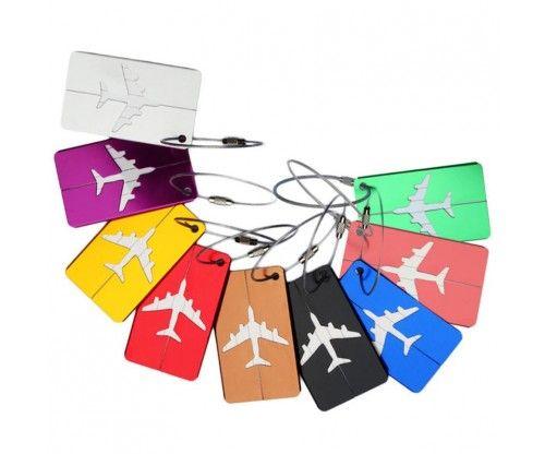 Repülős bőrönd jelölő címke fémből. A poggyász azonosítón nevet, címet is feltüntethetsz.