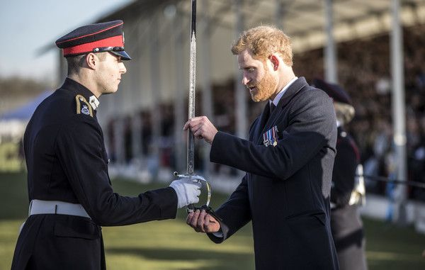 Prince Harry Photos - Prince Harry presents the sword of honour to the best overall officer cadet at Sandhurst during the Sovereign's parade ceremony at Royal Military Academy Sandhurst on December 15, 2017 in Camberley, England. - Prince Harry Attends the Sovereign's Parade