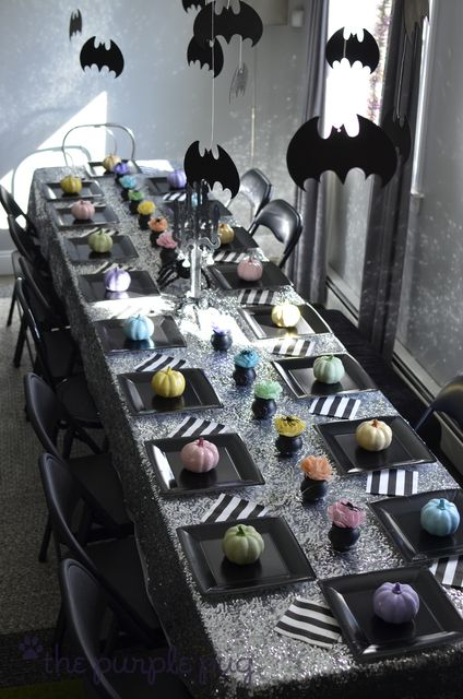 Awesome Halloween Table Decor - Colored mini pumpkins, glittering silver table cloth, black and white striped napkins