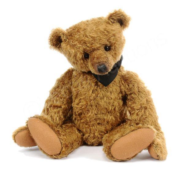 "Mary George Bears Artist Teddy Bear by Mary George (USA), cinnamon curly mohair teddy bear, black shoe button eyes, black waxed nose, brown wool felt pads, wearing black dickie-bow, swing tag, Near Mint, 19""/48cm."