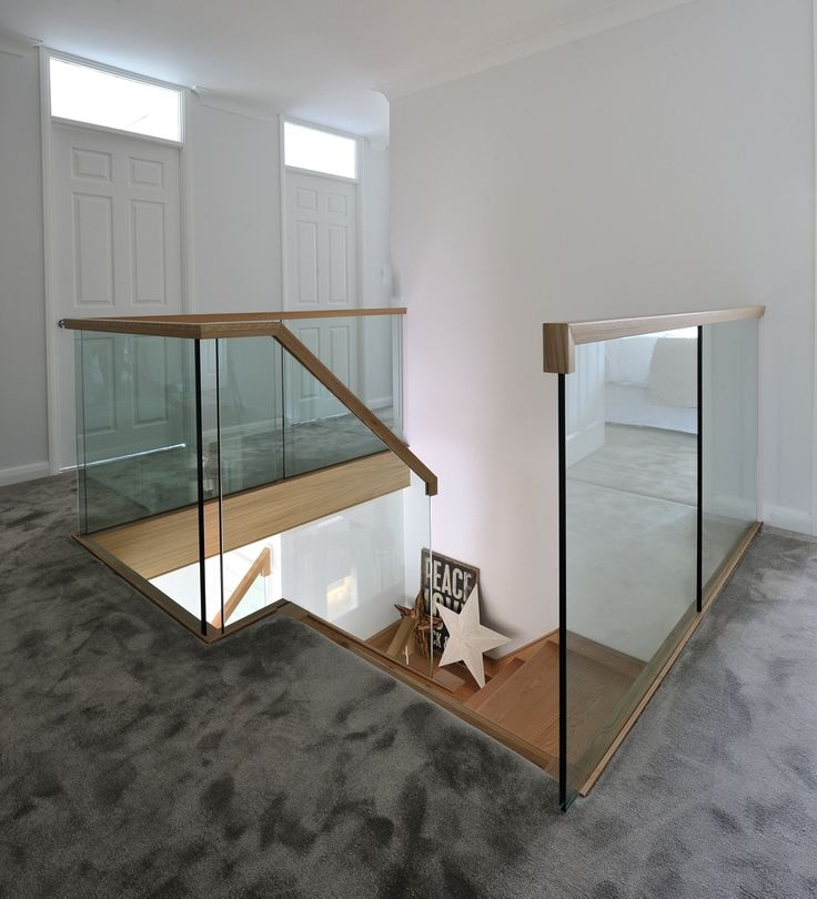 Landing shot of the contemporary, oak and glass staircase we created for this beautiful family home.