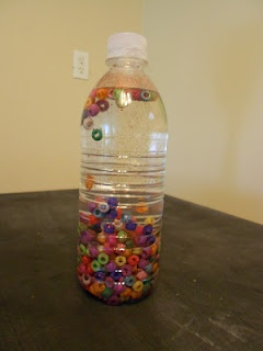 toddler craft shaker, could also do feathers, foam shapes and yarn or sparkles, to avoid choking hazzards.