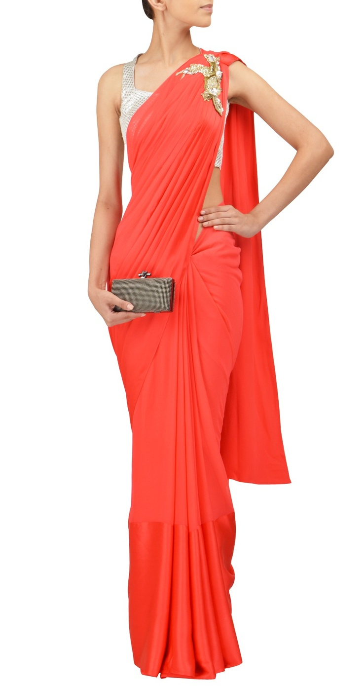 Pleated plain sari with emb on shoulder and full choli