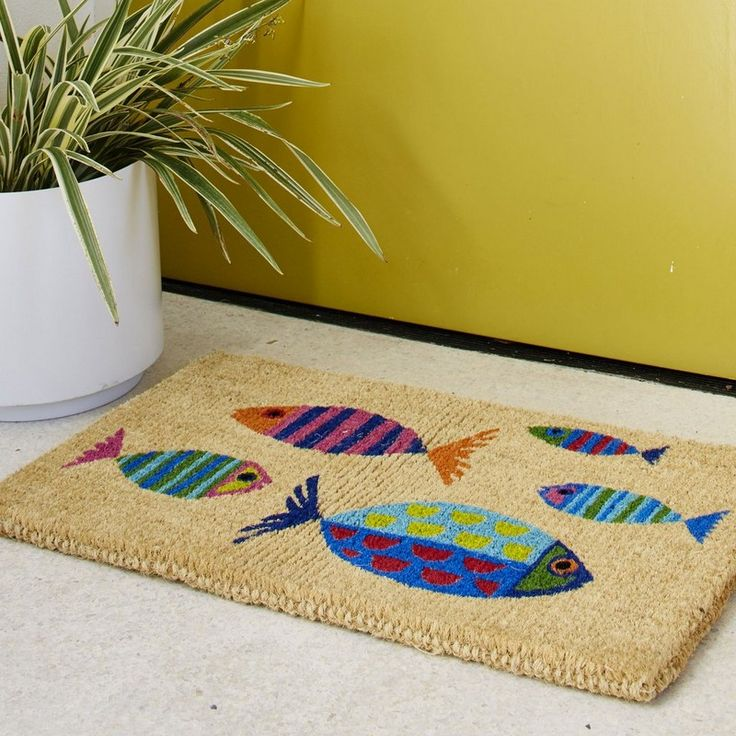 coir mat u2013 calypso fish a school of tropical fish on this coir doormat brighten your doorstep in brilliant stripes and geometrics