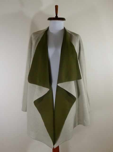 Double sided waterfall blazer in cream and forest green.