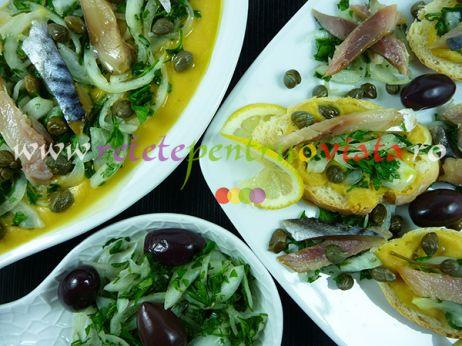 Aperitiv cu piure de naut si scrumbie afumata servit cu salata de patrunjel si ceapa - un aperitiv foarte gustos, consistent si sanatos.