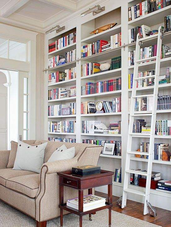 For a large book collection, tilt books in different directions to make the entire bookcase look more visually interesting. Books can be stacked horizontally on top of one another, vertically, and even lean at an angle to add visual rhythm to a bookcase filled to the brim. Decorating with Books: Decorating Ideas from (and with) the Pages of Your Favorite Books