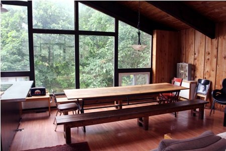 An Eight bedroom Swiss Style Chalet that sleeps 20 people and has a wood burning fireplace