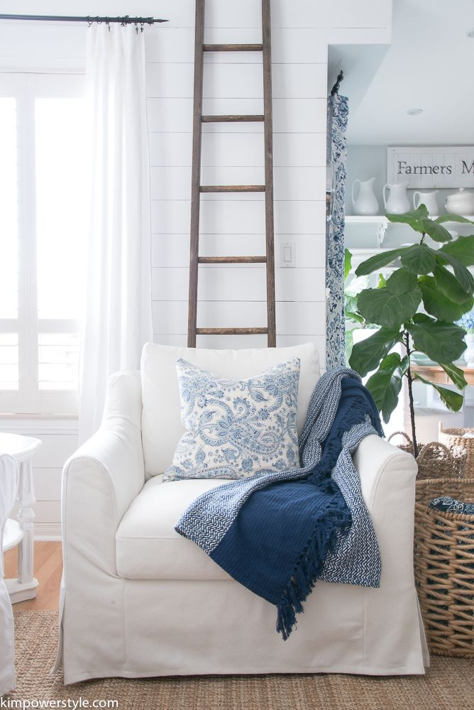 White on white with natural wood textures and a lovely pop of blue. Cozy, clean, charming!