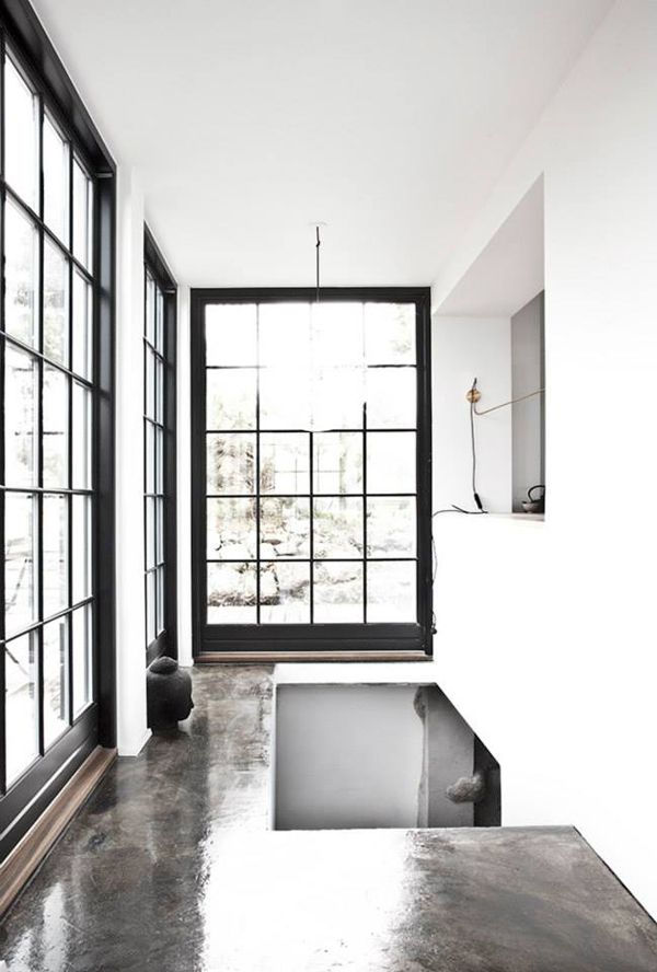 cement floors + black divided light windows