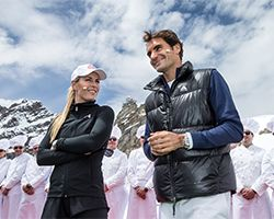 ROGER FEDERER  vs LINDSAY VON - For the opening of the Lindt Swiss Chocolate Heaven - the highest Lindt Chocolate Shop on the Jungfraujoch (3454 m a.s.l.) - tennis champion Roger Federer challenged American ski racer Lindsey Vonn on a court in the middle of snow and ice.