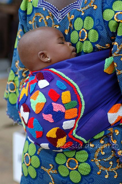 Such a classic scene. Baby tied to Mommy's back - BelAfrique your personal travel planner - www.BelAfrique.com