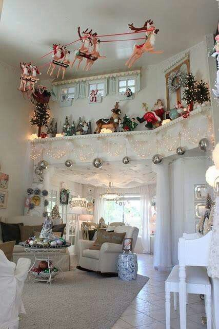 Sleigh hanging from ceiling Christmas decor