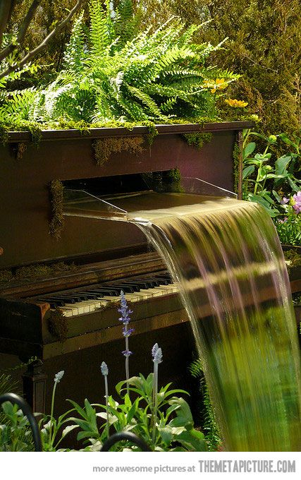 cascading waterfall fountain---what an amazing use for an old piano!!! i see so many old piano's on craigslist that are beyond repair!! can't wait til i have a yard...i am def doing this!!!!
