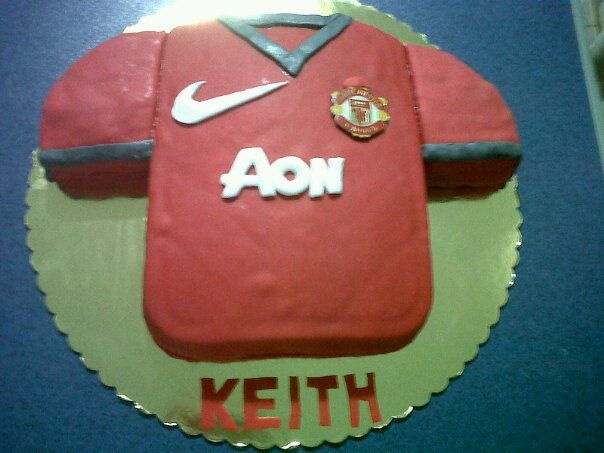 Birthday Cake for my youngest brother... Manchester United Football Kit made with fondant ... Cake flavour - Chocolate cake by Buddy Valastro -The Cake Boss with chocolate ganache