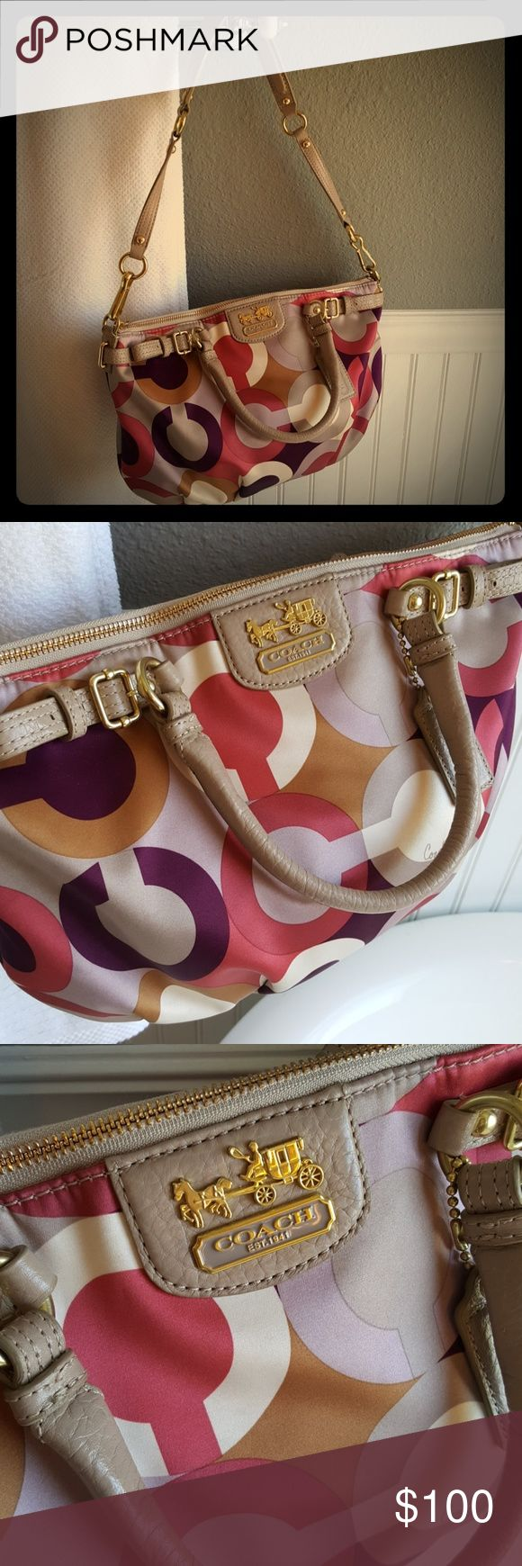 GORGEOUS CONDITION Coach Purse! Selling a GORGEOUS CONDITION Coach Purse! This purse is in impecable condition, very clean just a minor spot on the back side behind the left hardware of handle. I will leave up to buyer to get the spot out. This purse is absolutely gorgeous! Beautiful colors! This has the stage coach emblem which is a unique feature. Coach Bags