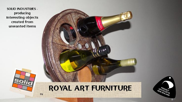 Old school film reel transformed into a wine rack. Solid Industries, Royal Art furniture, upcycle