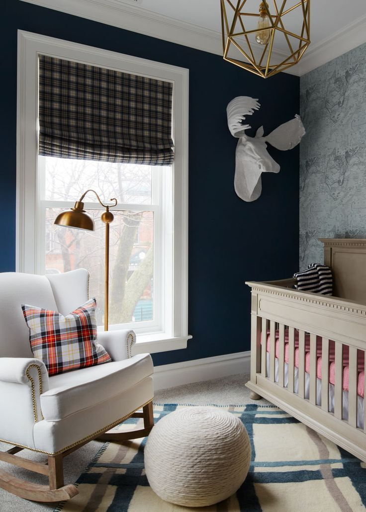 Jonas gentlemanly nursery, with its navy walls and tartan window treatments, was inspired by a cigar bar.