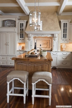 Love the contrast of the light cupboards with wooden floors