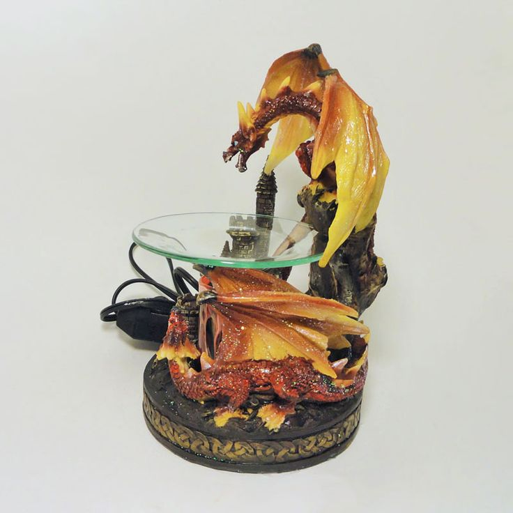 Colorful Fighting Dragons Electric Scented Oil Warmer - FOR SALE at Claudia's Bargains! Red and orange dragons fighting near an ancient castle electric scented oil warmer with dimmer dial. Attractive home accent piece - in use or not. Buy Now