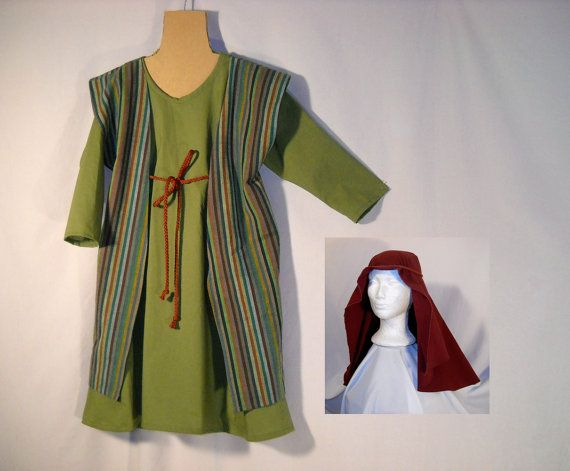 This is a shepherd or Joseph or Innkeeper costume for your Christmas Nativity Play. In stock and ready to ship. The robe is olive green cotton blend, the over robe is printed striped cotton in multicolor stripes. Comes with a cord belt. The headscarf is dark burgundy, with a cord. This is approximately a kids size 5. The chest measures 32 inches, so will comfortably fit up to a 27 inch chest. The length is 32 inches from the shoulder to the hem. Easily shortened, but there is no extra…
