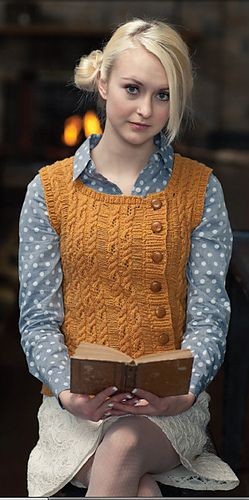Heliopath Vest by Emma Welford. I like the asymmetric button band, but not the cable pattern.