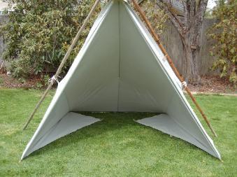 TarpSetUp Interesting. Single flat tarp used as shelter.