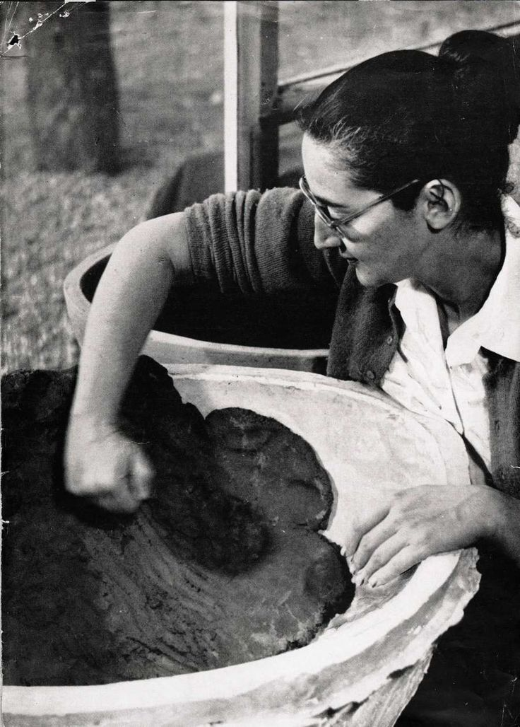 """14 Women Artists Whove Changed The Way We Think About Design. 12. Karen Karnes New York City-born Karen Karnes is most famous for her stoneware ceramics, influenced by her training in both Italy and at Black Mountain College in North Carolina. Her earth-colored clay pieces are created using older practices like wood and salt firing. Of her work, she notes: """"When I started working, I thought, well, I'm a potter. I want to make pots. I'm making pots. And then when I moved from doing that to…"""