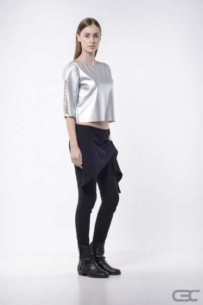 http://cbcdesign.ro/en/shop/crop-top-platinum/  Shiny and sleek crop top which, through it's intrinsic sleeve detailing design and it's low shoulder, makes an interesting and mysterious product. The ¾ sleeves show the wrist and this creates an appealing chic touch. The raw finish sustains the casual sport direction, but the accessories and the styling can create a totally different story.