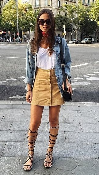 Button-front suede skirt, denim jacket, and gladiator sandals.