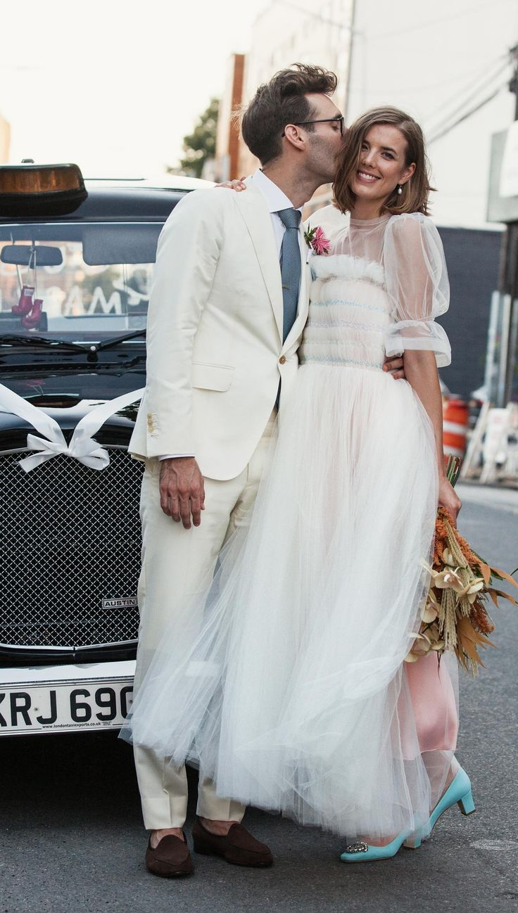 Agyness Deyn in a Molly Goddard wedding dress and Manolo Blahnik shoes, with flowers by Doan Ly, and Joel McAndrew in a J. Mueser suit.