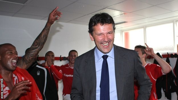 Celebrating promotion from League One in the dressing room with the players.