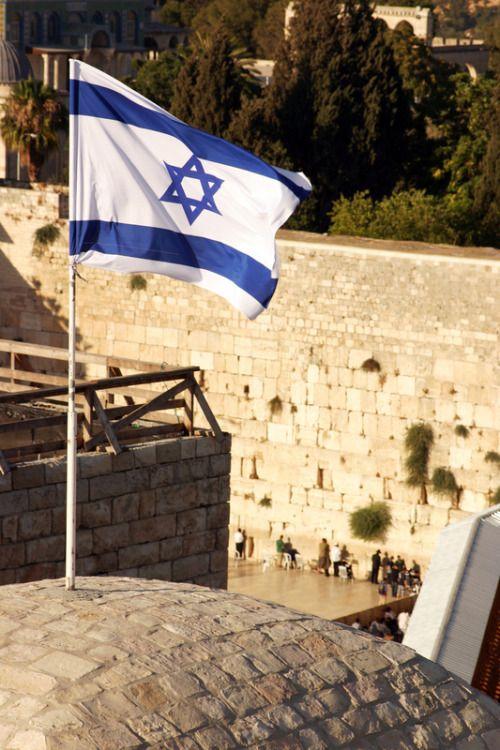 Israel flag near the Kotel . Jerusalem