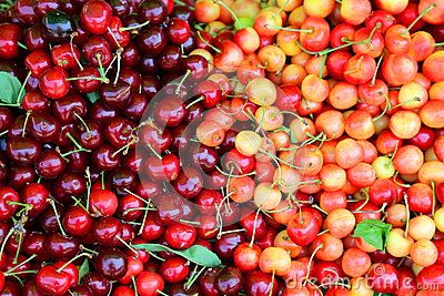 Red and yellow cherries gathered in one place.