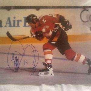 Theoren Fleury autographed Calgary Flames 8x10 photos