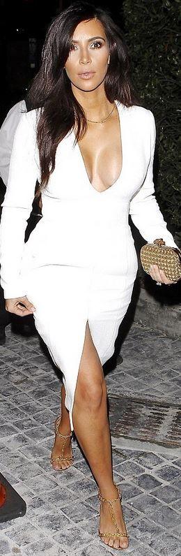 Kim Kardashian: Dress – Wes Gordon  Shoes – Tom Ford  Purse – Bottega Venetta