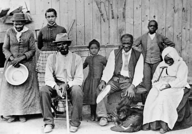 Picture of Harriet Tubman, underground railroad conductor and advocate of human rights, with some of the people she helped to escape from slavery.