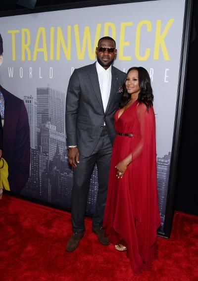 """LeBron James, who hopes that the sequel to """"Trainwreck"""" quickly kills off Bill Hader therefore promoting him to leading man status, definitely didn't play the part of supporting actor in a a gray suit and tortoise sunglasses. His wife, Savannah Brinson, looked lovely in a red chiffon gown."""