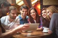 Group of friends in the coffe shop stock photo