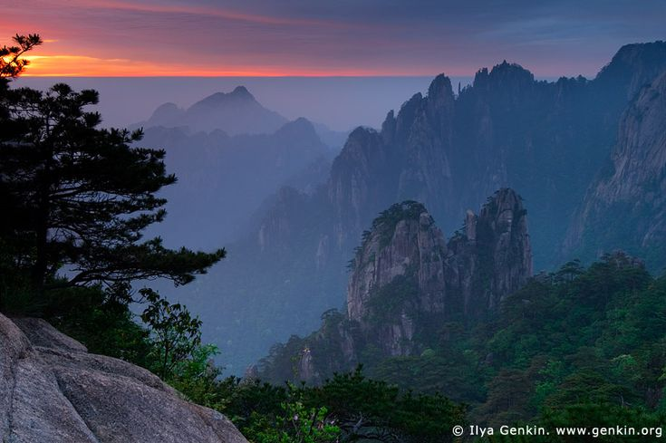 Sunrise from Stone Monkey Gazing Over a Sea of Clouds Lookout, Baiyun Scenic Area, Huangshan (Yellow Mountains), China.