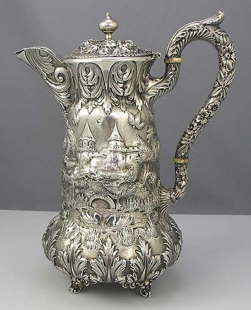 "Schofield Co sterling silver chocolate pot in the ""Landscape"" or ""Architectural"" pattern, featuring a castle motif, c1910 (Britannia Silver)"