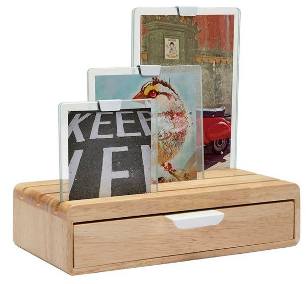 Slider Photo Display Drawer Combo by Umbra A wooden photo display with an added drawer for storage floats 3 photos on top in glass panes. The idea behind the Photo Slide was to combine two functions into one compact product.