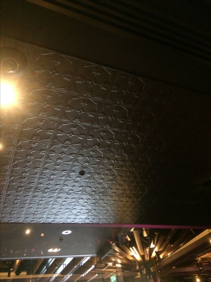 PHOTO1 * This pressed tin panels used on the ceiling of a bar in the Crown Casino gives the room an intimate charm. The dark grey enhance the masculin spirit, we would have a nice Whiskey here with some cigars.