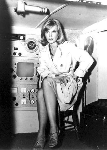 Anne Francis as Honey West (I used to play being Honey West, with a fake gun, and an eye pencil beauty mark!)